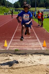 Amni Shetty (17) attempts the long jump.