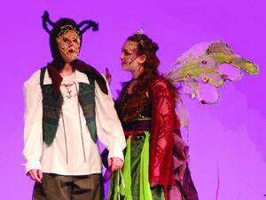 (L to R) Brice Sinnett playing Nick Bottom; Kate Davignon playing Titania.