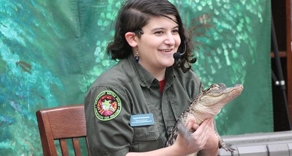 Sarah Fleischmann uses an alligator arm to wave to the crowd.